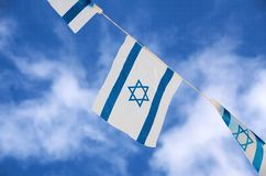 Israel Flags Independence Day. Israeli flags showing the Star of David hanging proudly for Israel's Independence Day (Yom Haatzmaut Stock Photos