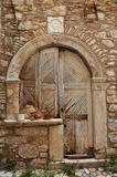 In israel gri old craftmanship door and cat. Very beautiful brown historic door royalty free stock photo