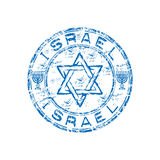 Israel grunge rubber stamp. Blue grunge rubber stamp with the Star of David and menorah symbol. Israel rubber stamp Stock Photography