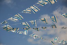 Israel Flags on Independence Day. Israeli flags showing the Star of David hanging proudly for Israels Independence Day (Yom Haatzmaut Royalty Free Stock Image
