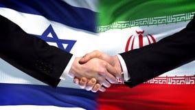 Israel and Iran handshake, international friendship relations, flag background. Stock photo royalty free stock image