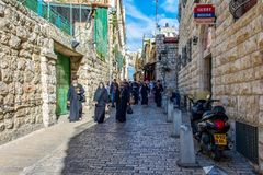 Israel / Jerusalem - 03.23.2016: Orthodox tourists are walking along Via Dolorosa to the Church of the Holy Sepulcher royalty free stock photos