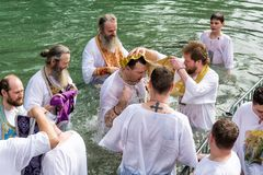 Israel / Jordan River - 03.26.2016: Christian pilgrims during the baptism ceremony on the Jordan River in Northern Israel the royalty free stock photography