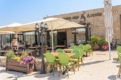 ISRAEL -July 30, - Café-Restaurant Аresto in the open air in the summer park in Caesarea, Israel- 2015. ISRAEL -July 30, - Café-Restaurant Аresto in Stock Photography