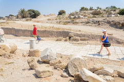 ISRAEL -July 30, - Tourists are going to be released in the park Caesarea, Israel,  columns, Greek, Byzantine, 2015 Stock Image