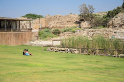ISRAEL -July 30, - Two teen girl sitting on the grass in the ancient Park of Caesarea, Israel - Caesarea 2015 - Caesarea 2015 Royalty Free Stock Photography