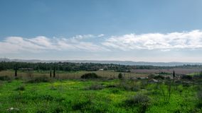 Israel landscape timelapse, clouds moving over green field. And traffic in the background stock video