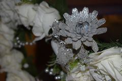 Decorative artificial gray and white flower- decoration on the wedding night royalty free stock images