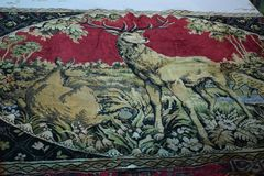 Retro carpet on the wall, depicting a deer royalty free stock photography