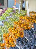 Israel market produce: plum, persimmon, pear Royalty Free Stock Photo