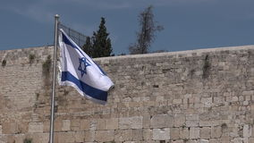 Israel national flag against the Western Wall stock video