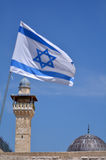 Israel national flage and Al-Aqsa Mosque in Jerusalem Old City I. JERUSALEM - MAR 19 2015:Israel national flage and Al-Aqsa Mosque.Jerusalem Old City is under Stock Photo