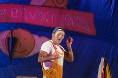 Israel, the Negev, Beer-Sheva - 2015 Hanukkah celebration in the youth theater. An actor wearing a mask and an inscription. In Hebrew Stock Photo