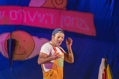 Israel, the Negev, Beer-Sheva - 2015 Hanukkah celebration in the youth theater. An actor wearing a mask. And an inscription in Hebrew Stock Image