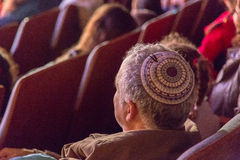 Israel, the Negev, Beer-Sheva -A man with a stack of color - in the audience, sitting back, 2015 Royalty Free Stock Photography