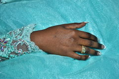 Israel, Negev, 2016 - Bride& x27;s hand with a wedding ring of gold in a turquoise dress Royalty Free Stock Photography