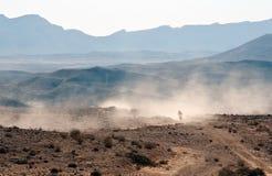 Bike crossing a stone desert. Israel. Negev Desert. Big Crater Royalty Free Stock Images