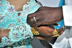 Israel, Negev, 2016 - Hands a bride in a turquoise dress and groom with gold Royalty Free Stock Images