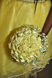 Israel, Negev, 2016 - Wedding bouquet of yellow roses with beads and yellow dress Royalty Free Stock Photography