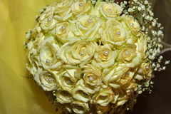 Israel, Negev, 2016 - Wedding bouquet of yellow roses with beads and yellow dress Royalty Free Stock Photos