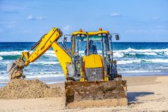 15/12/2018 Israel, Netanya, the driver of the excavator runs a bucket of manipulator, performs the repair of a public beach on a s stock photo