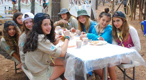 Israel Scouts members in a summer camp mess hall. Unidentified Israel Scouts members aged 15-18 in a summer camp mess hall on July 22, 2013 in Zipori Forest Stock Image
