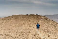 Hiking in israeli stone desert. Israel travel trek in desert backpackers tourism Royalty Free Stock Images