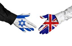 Israel and United Kingdom diplomats shaking hands for political relations. Hands of two important leaders with national flags for the countries of Israel and Stock Images