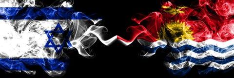 Israel vs kiribatiska rökiga mystikerflaggor förlade sidan - vid - sidan Tjockt kulört silkeslent röker flaggan av Israel och Kir royaltyfri foto