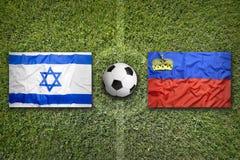 Israel vs. Liechtenstein flags on soccer field Royalty Free Stock Image