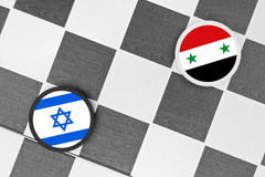 Israel vs Syria. Draughts (Checkers) - Israel vs Syria - conflict between states because of annexation of Golan heights territory royalty free stock photography