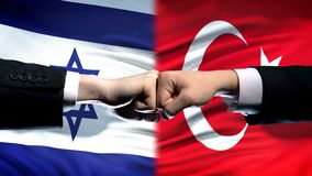 Israel vs Turkey conflict, international relations, fists on flag background. Stock photo royalty free stock image