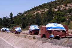 Israel Wars Memorial Day - Yom Hazikaron. War memorials of Armored trucks outside Jerusalem in Shaar HaGai are covered with Israeli flags near Burma road to stock photo