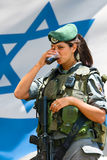Israeli army girl. JERUSALEM, ISRAEL - MAY 30, 2011: Unidentified Israeli army girl drinks Coca-Cola at the Israel Expo, one of the largest celebration of Israel Royalty Free Stock Photo