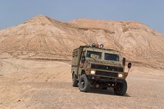 Israeli army Humvee on patrol in the Judean desert. Israeli army Humvee on patrol in the rocky Judean desert stock image