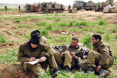 Israeli army soldiers resting during ceasefire. GAZA STRIP -JAN 17 2009:Israeli army soldiers are resting on the Jewish holiday of Shabbat during ceasefire with Stock Photography
