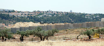 Israeli Army by the Wall of Separation Stock Image