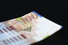 Israeli banknote hundred shekels on a dark background Stock Photo