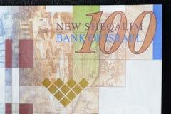 Israeli banknote hundred shekels on a dark background Stock Images