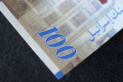 Israeli banknote hundred shekels on a dark background Stock Photo