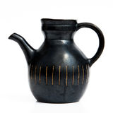 Israeli black ceramic jug in retro style on white Stock Photos