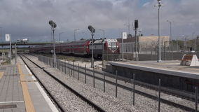 Israeli Bombardier double-deck coach enters Ashkelon train station. ASHKELON, ISR - APR 20 2015:Israeli Bombardier double-deck coach enters Ashkelon train stock video footage