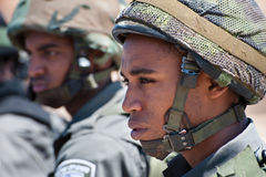 Israeli Border Police Soldier. AL-WALAJA, OCCUPIED PALESTINIAN TERRITORIES - AUGUST 27: Soldiers of the Israeli Border Police (Magav) stand at a protest by stock image