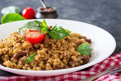Israeli couscous with beef. Tasty food. Asian meal stock photo