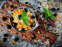 Israeli couscous ptitim with pumpkin, grapes and fresh mint Royalty Free Stock Image