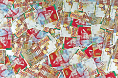 Israeli currency. Shekels bills pile royalty free stock images
