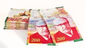 Israeli currency. Big stack of Israeli currency - shekel bills isolated Royalty Free Stock Photos