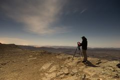 Photographer in a desert night Stock Image