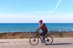 Israeli elderly man rides a bicycle Royalty Free Stock Image