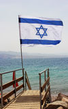 Israeli flag against the background of the Red Sea Stock Photos